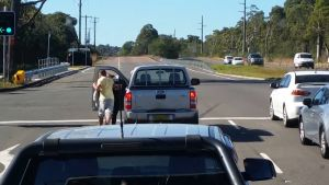 A man punches a woman after an apparent road rage incident on the NSW central coast.