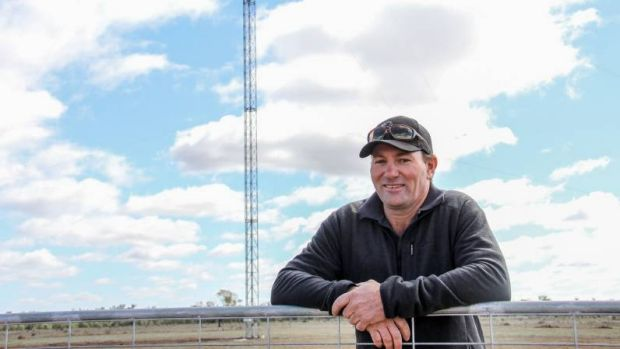 Queensland farmer Andrew Sevil with his 53-metre tower.
