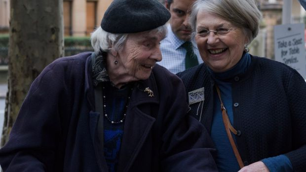 Myra Demetriou, left, the last resident of the Sirius building, enters the NSW Land and Environment Court on Tuesday.