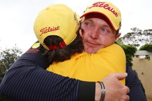 Golfer Jarrod Lyle hugs his wife Briony, after playing the Australian Masters in 2013, his return to golf after beating ...
