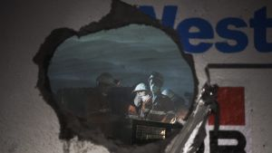 Workers peer though a hole created by a boring machine where two sections of tunnel meet below Concord.