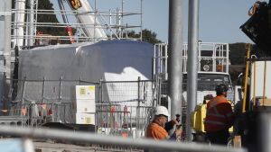 A tram is seen covered in plastic at Randwick Racecourse station construction site in Sydney.