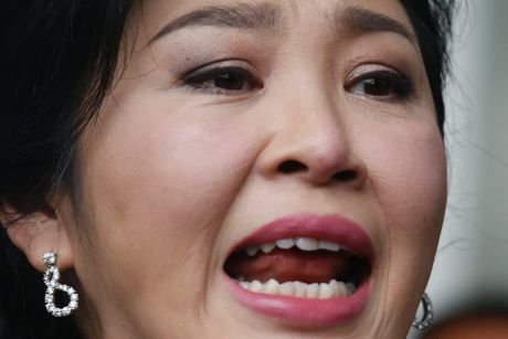 Thailand's former prime minister Yingluck Shinawatra talks to reporters on the last day of a hearing in Bangkok.