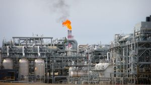 A flame blazes on top of flare stacks at a plant at the Queensland Curtis Liquefied Natural Gas Project.