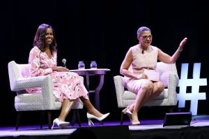 Former First Lady Michelle Obama speaks, emphasizing that women must celebrate their strength, during a live ...