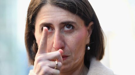 NSW Premier Gladys Berejiklian gestures before a press conference on council amalgamations.