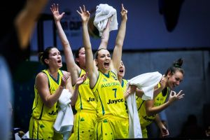 The Opals bench, led by Maddie Garrick (No.7), celebrate a three-pointer in their win over North Korea.