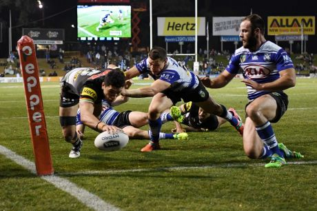 Try time: Dallin Watene-Zelezniak touches down to give Penrith the lead in the second half.