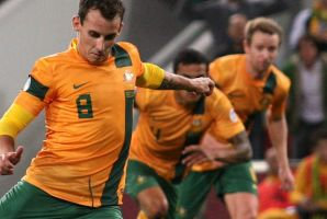 BRISBANE, AUSTRALIA - JUNE 12: Luke Wilkshire of Australia scores with this penalty shot at goal during the FIFA World ...