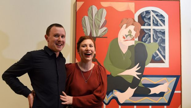 Mitch Cairns, the winner of the Archibald Prize, with his winning painting and its subject, his artist partner Agatha ...