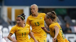U.S. forward Mallory Pugh, second from left, moves the ball away from Australia's Lisa De Vanna (11), Tameka Butt (13) ...