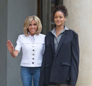 Brigitte Macron, left, the wife of French President Emmanuel Macron and singer Rihanna pose for the media after a meeting.