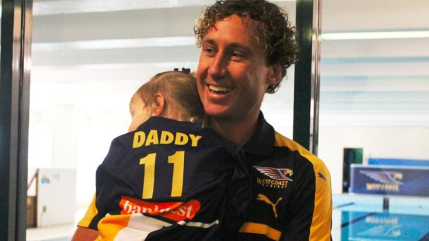 Matt Priddis with his daughter after his press conference.