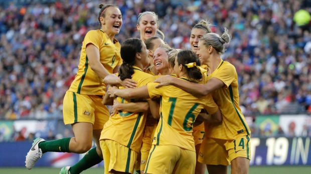 Australian players celebrate as they surround Tameka Butt, goalscorer against the US at the Tournament of Nations.