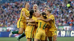Australia players celebrate as they surround Tameka Butt, obscured, after she scored a goal against the United States ...
