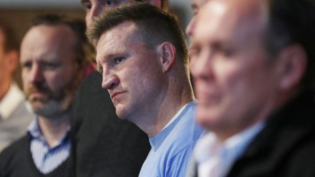 Collingwood coach Nathan Buckley watches as CEO Gary Pert announce his resignation.