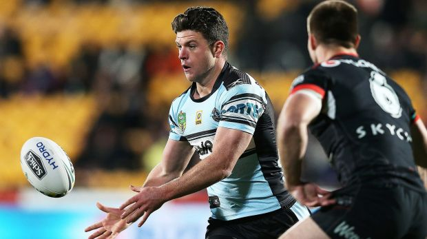 AUCKLAND, NEW ZEALAND - JULY 28: Chad Townsend of the Sharks passes the ball out during the round 21 NRL match between ...