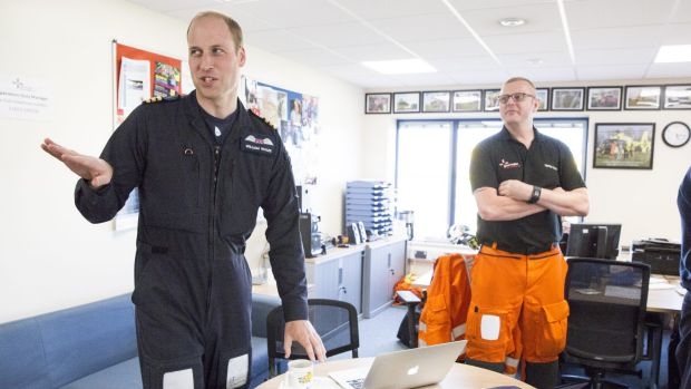Prince William with colleagues at his base before flying this final shift.