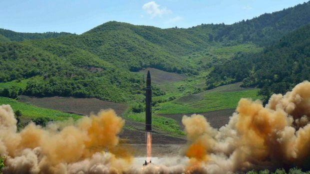 North Korea's first launch of a Hwasong-14 intercontinental ballistic missile, which took place in early July.