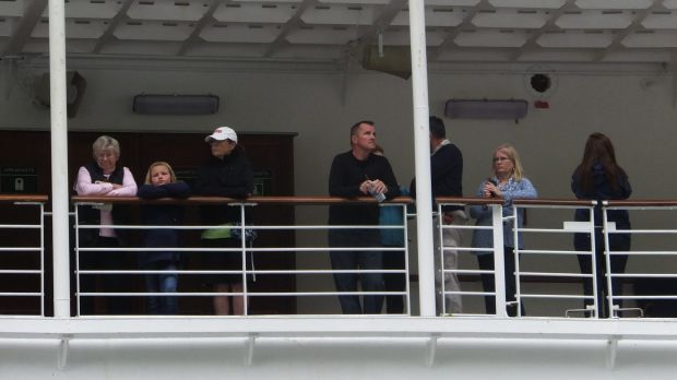 Passengers of the Emerald Princess cruise ship wait patiently while the FBI interviewed witnesses.
