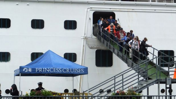 Passengers of the Emerald Princess cruise ship disembark following the incident.