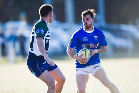 Royals' Andy Muirhead takes on Uni-Norths.
