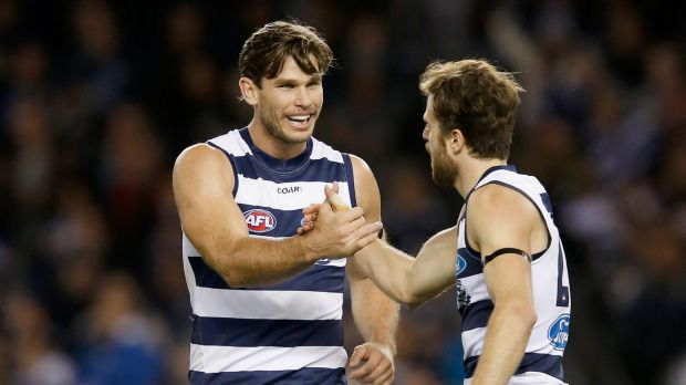 Tom Hawkins and Jordan Murdoch of the Cats celebrate a goal.