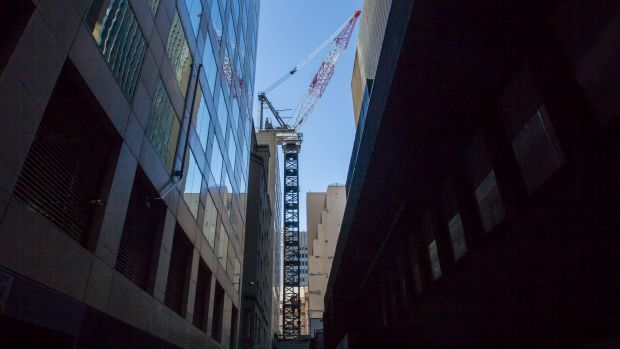 """The massive """"luffing"""" crane erected above St James Lane that will build the 57-storey tower on the tiny site."""