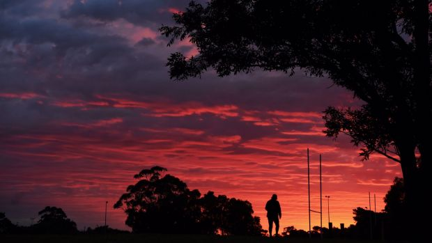Sydney's red dawn on Monday ahead of some relatively rare winter rain.