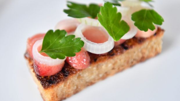 Bone marrow on toast with onion.