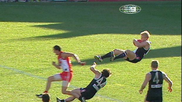 Nick Riewoldt [St Kilda] running back with the flight of the ball, takes one of footy's great marks in 2004 at the SCG