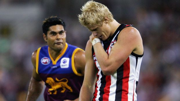 Nick Riewoldt is infamously targeted by Mal Michael after injuring his shoulder at the Gabba in 2005.
