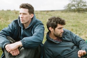 Josh O'Connor and Alec Secareanu star in the rural love story God's Own Country.