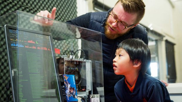 Eight-year-old Wooranna Park Primary School student Seth Yee and teacher Kieran Nolan with a server that authenticates ...