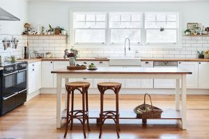 Elizabeth's farmhouse kitchen. Cabinetry details and island table by Aaron Pitt, and stools from Gumtree.