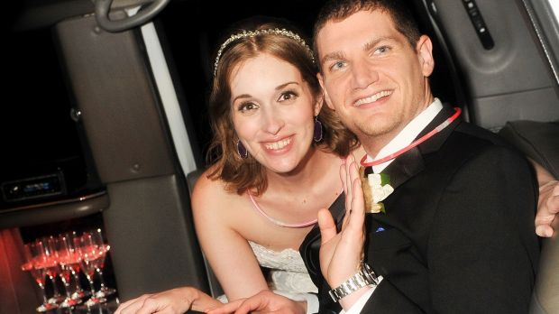 Neely and Andrew Moldovan, shown on their wedding day, may have to pay their photographer $US1 million after a dispute ...