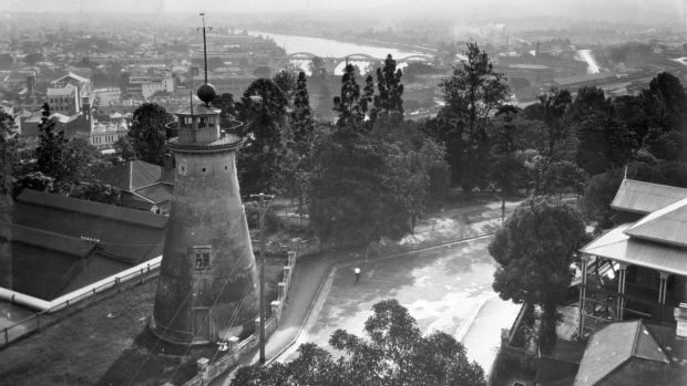 The Spring Hill windmill, photographed in 1933, with clear views of the Brisbane River.