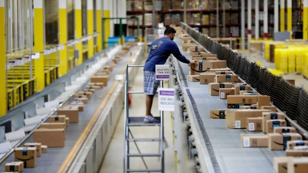 """The vast majority of Amazon's hiring is for what the company calls its """"fulfilment network"""" - the armies of people who ..."""