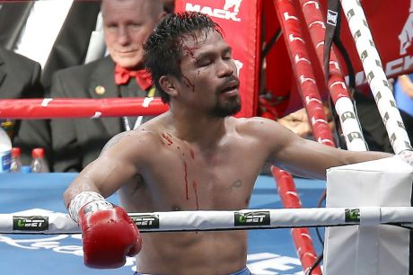 Disbelief: Manny Pacquiao reacts after his loss to Jeff Horn in Brisbane. He wants a rematch.