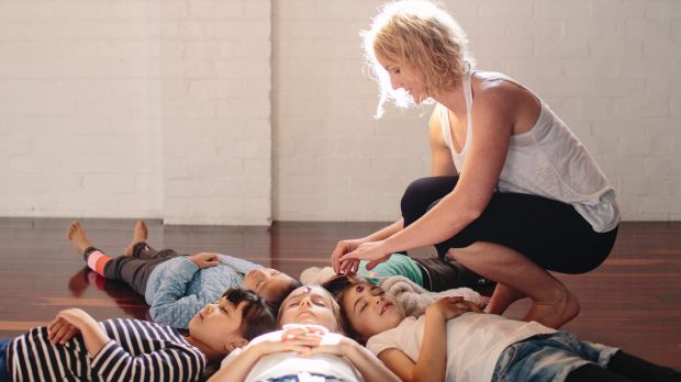 Radha Babicci teaches children mindfulness and yoga at a Sydney long day-care centre.
