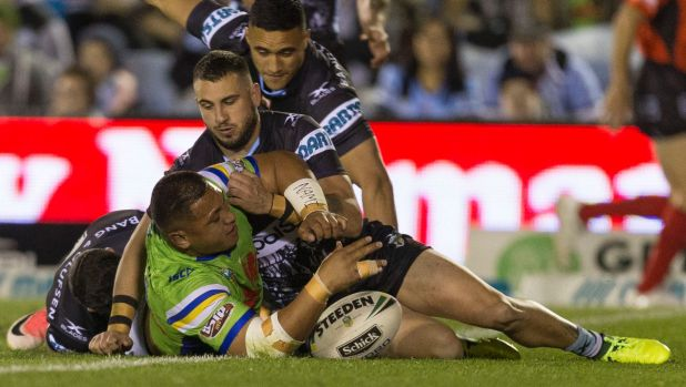 Raw power: Josh Papalii beats the tackles of Jack Bird and Chad Townsend to score.