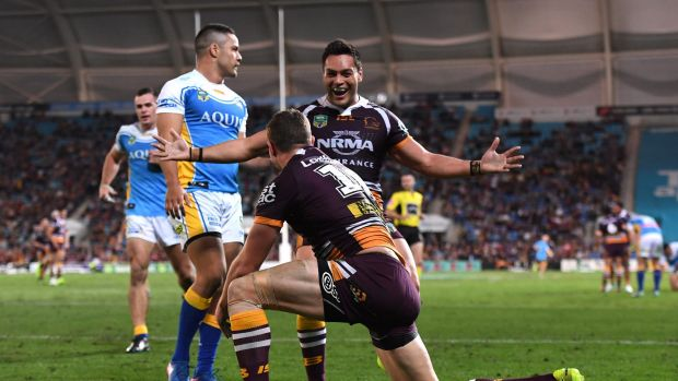 Rout: Alex Glenn rushed in to congratulate Corey Oates after another try.
