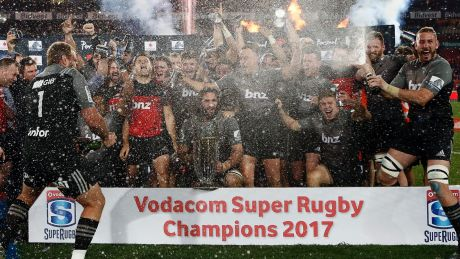 Champions: The Crusaders celebrate their Super Rugby final win against the Lions at Ellis Park.