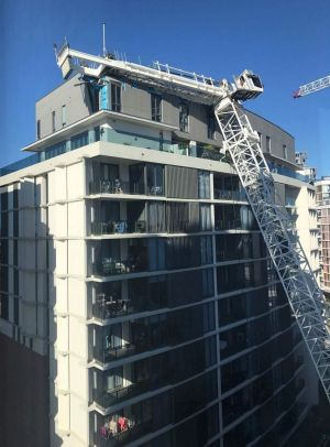 The view from a neighbouring window after the crane crashed onto the penthouse of a block of apartments at Wolli Creek.