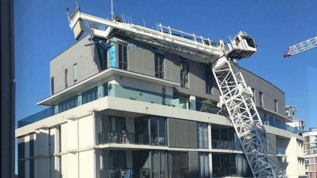 Crane falls on building, NSW