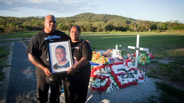 Too young: Peni and Lisa Fotuaika, parents of NRL player Mosese, pictured at the Brisbane cemetery where he was buried.