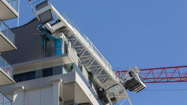 The penthouse apartment was destroyed by the crane's horizontal arm.