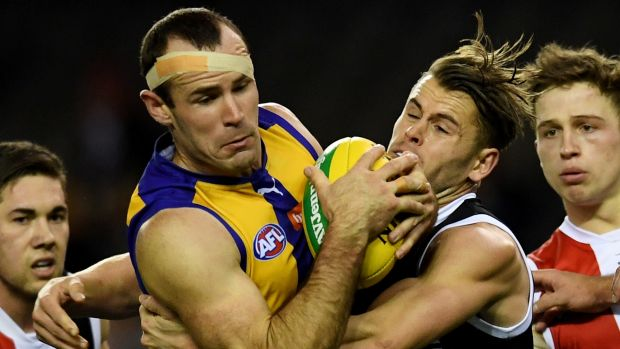 Gotcha: Eagle Shannon Hurn is wrapped up in a tackle.