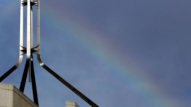 A rainbow forms over Parliament House in Canberra ahead of the Liberal party room meeting.