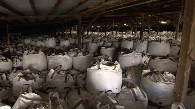 Four Corners found glass meant to be recycled was being stored in giant white bags in warehouses in Victoria.